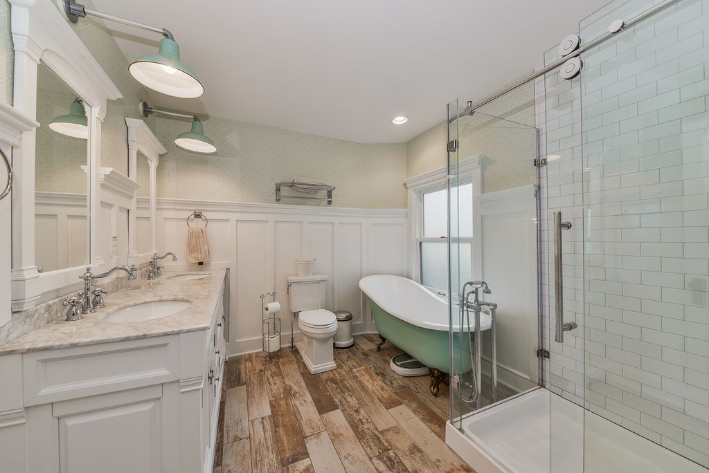 Restored Remodeled Queen Anne Victorian House Master Bathroom Subway Tile Plank Tile Floor High Wainscot Clawfoot tub