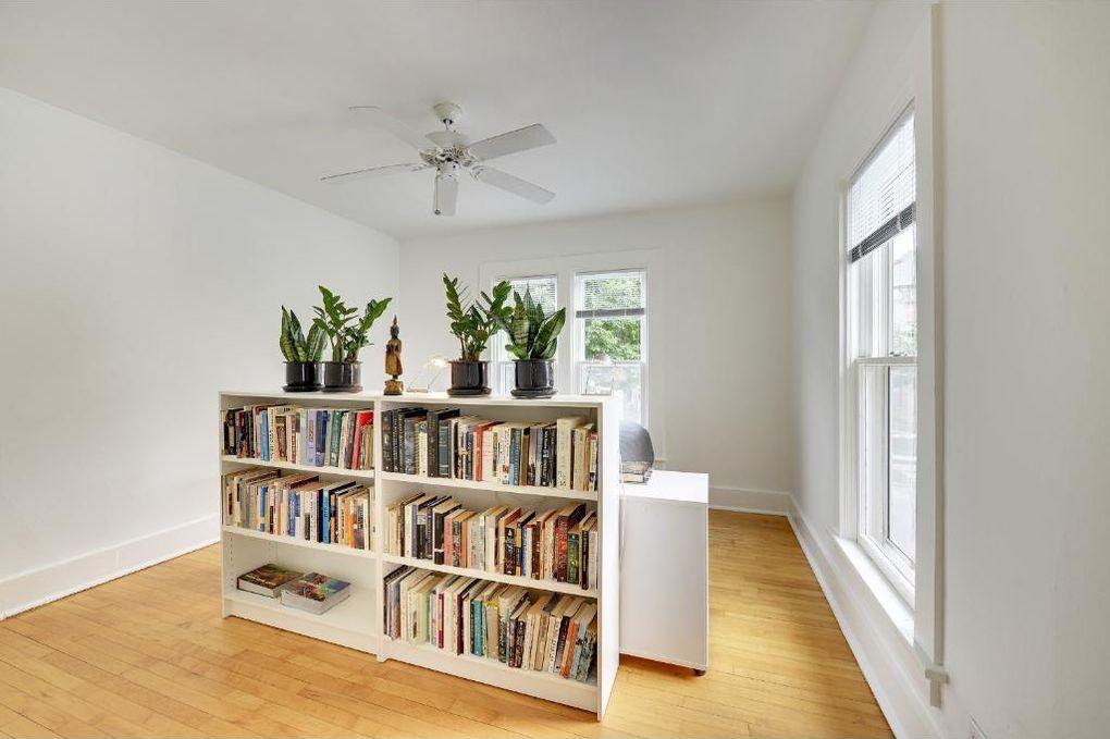 Folk Victorian House Master Bedroom Built In Bookshelf Headboard
