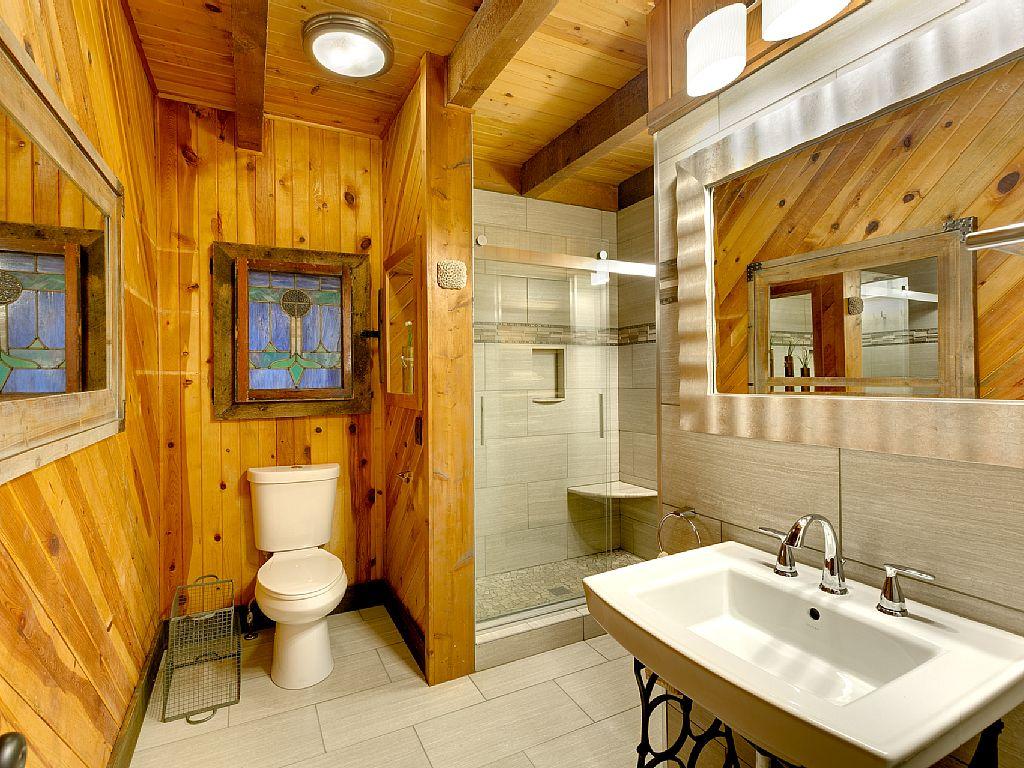 Rustic Cabin Master Bathroom Porcelain Tile Pedestal Sinks