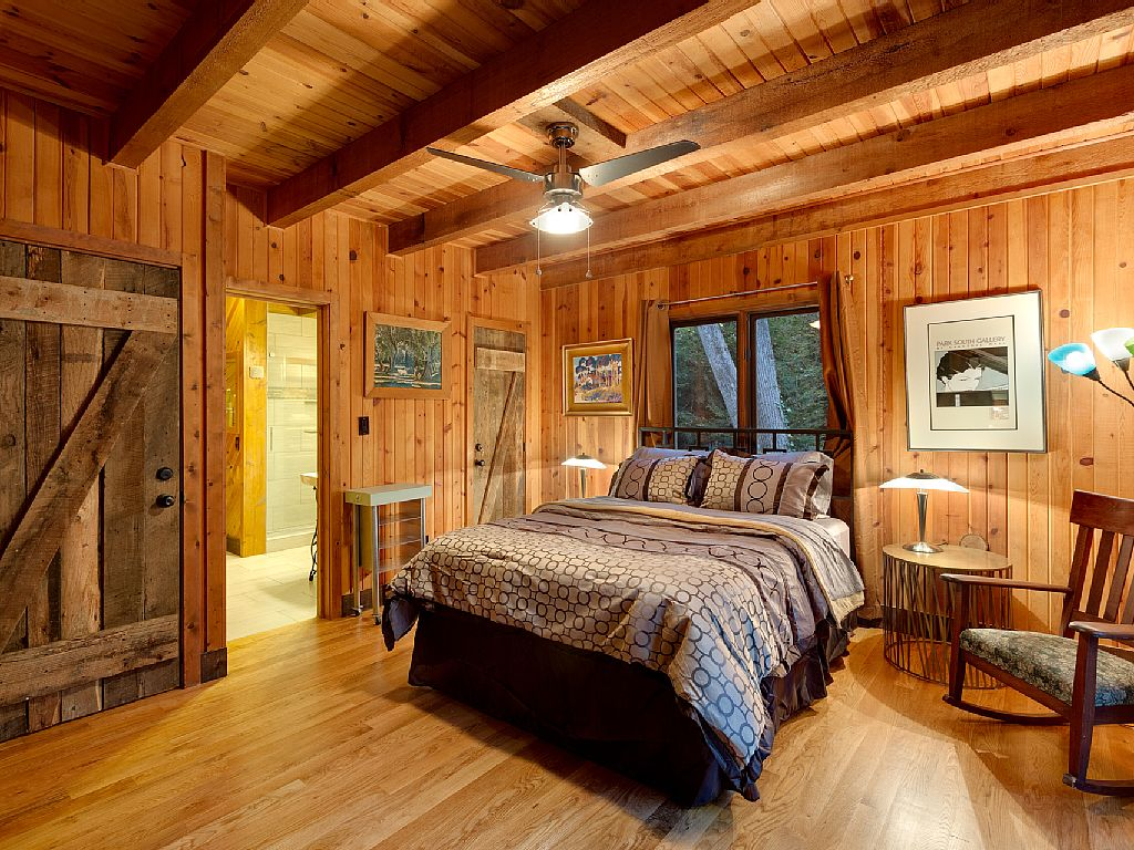 Rustic Cabin Master Bedroom Exposed Ceiling Beams Sliding Barn Door Wood Walls