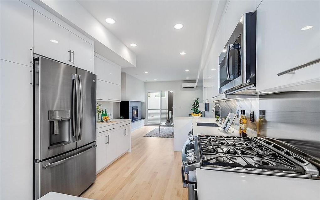 contemporary modern condo interior white kitchen stainless steel appliances