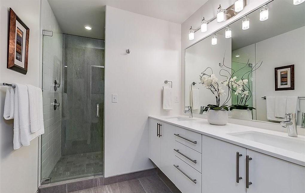 contemporary modern condo interior white master bathroom