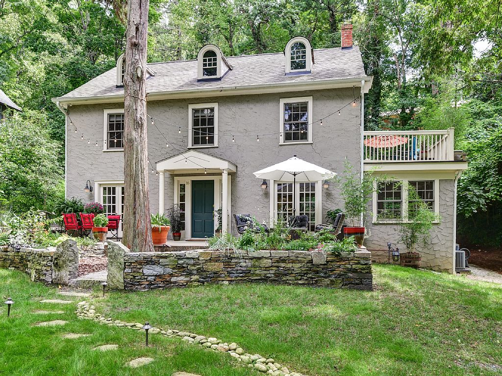 Colonial Two-Story Home Arched Dormers Stone Porch