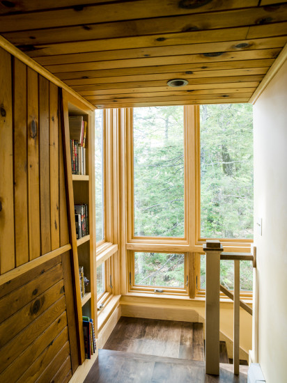 Contemporary lake house remodel windows stairwell