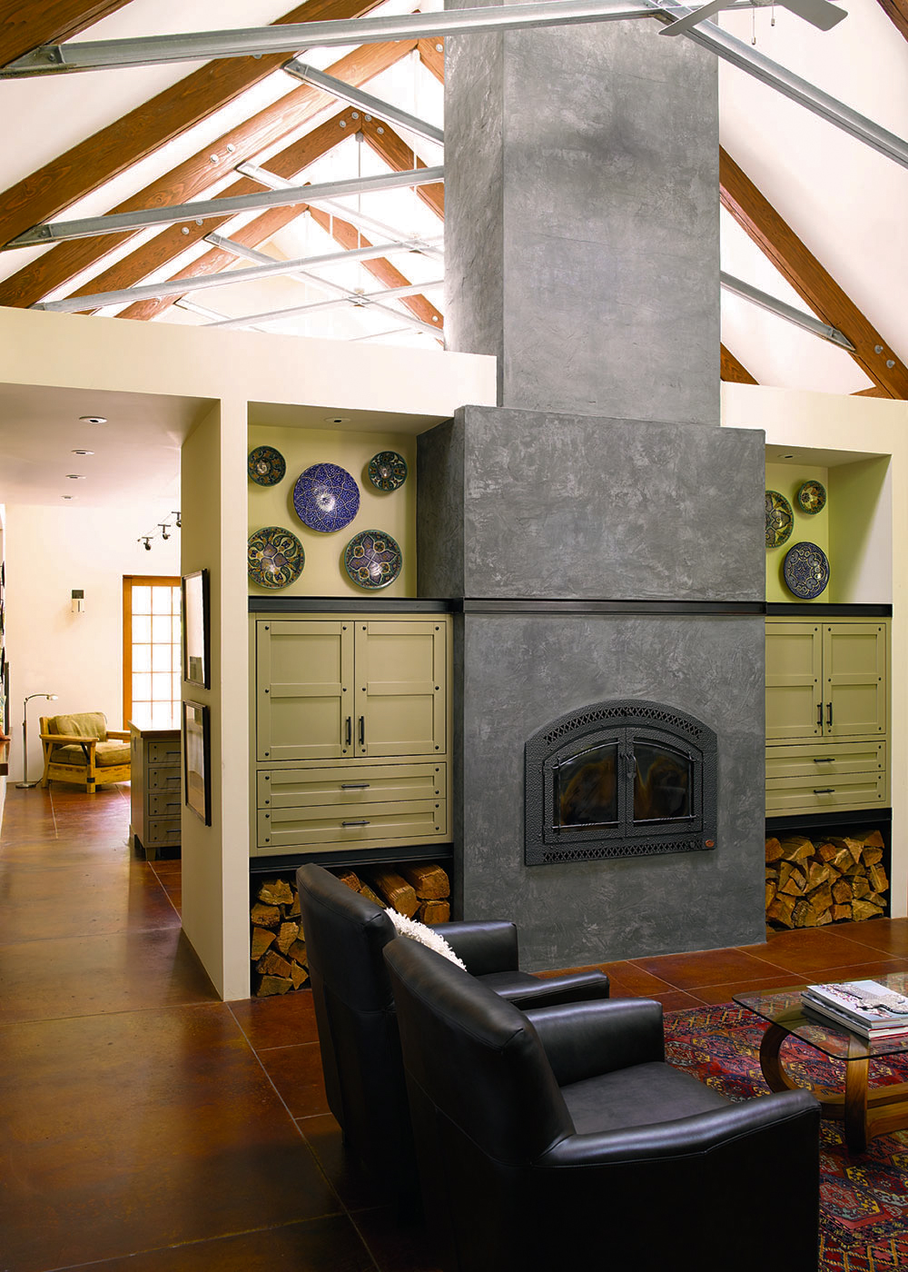 Barn house modern interior family room exposed trusses steel fireplace