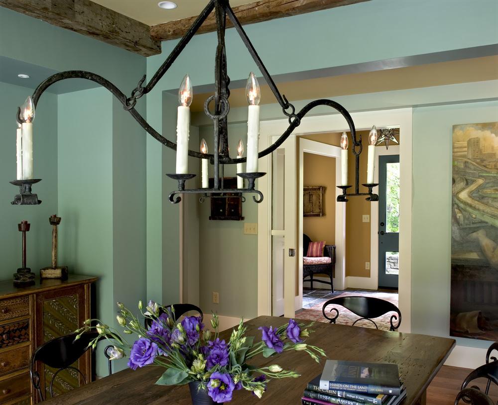 New Custom Farmhouse dining room rough hewn ceiling beams