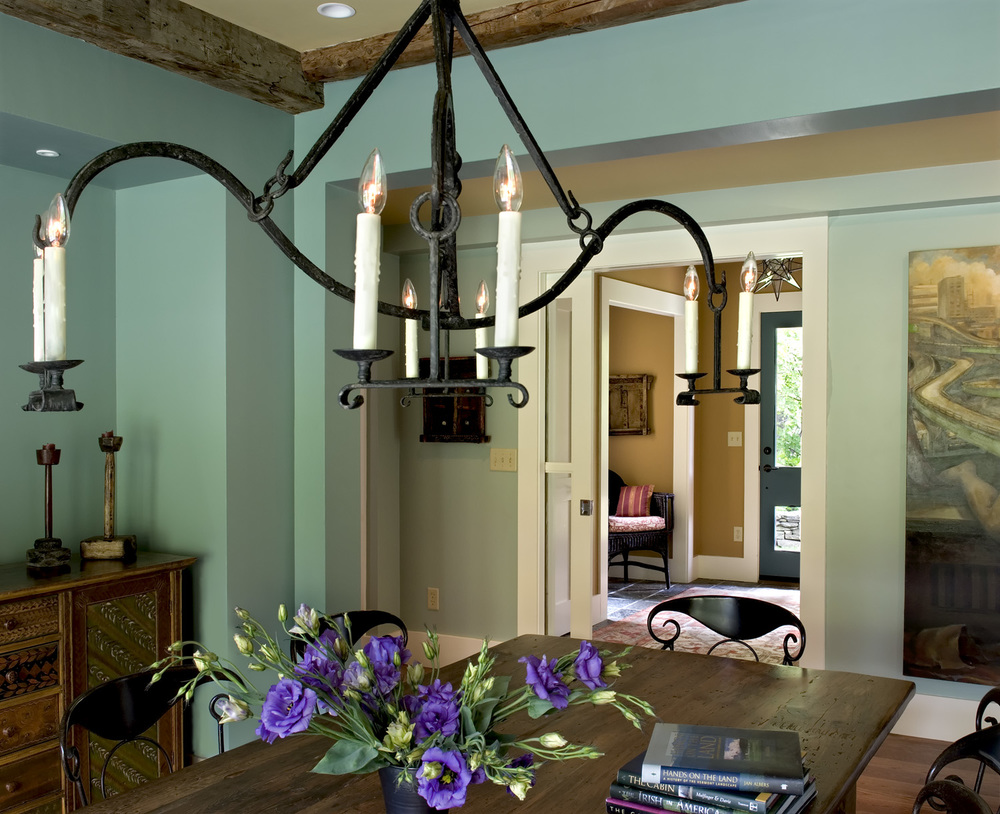 New Custom Farmhouse dining room rough hewn ceiling beams