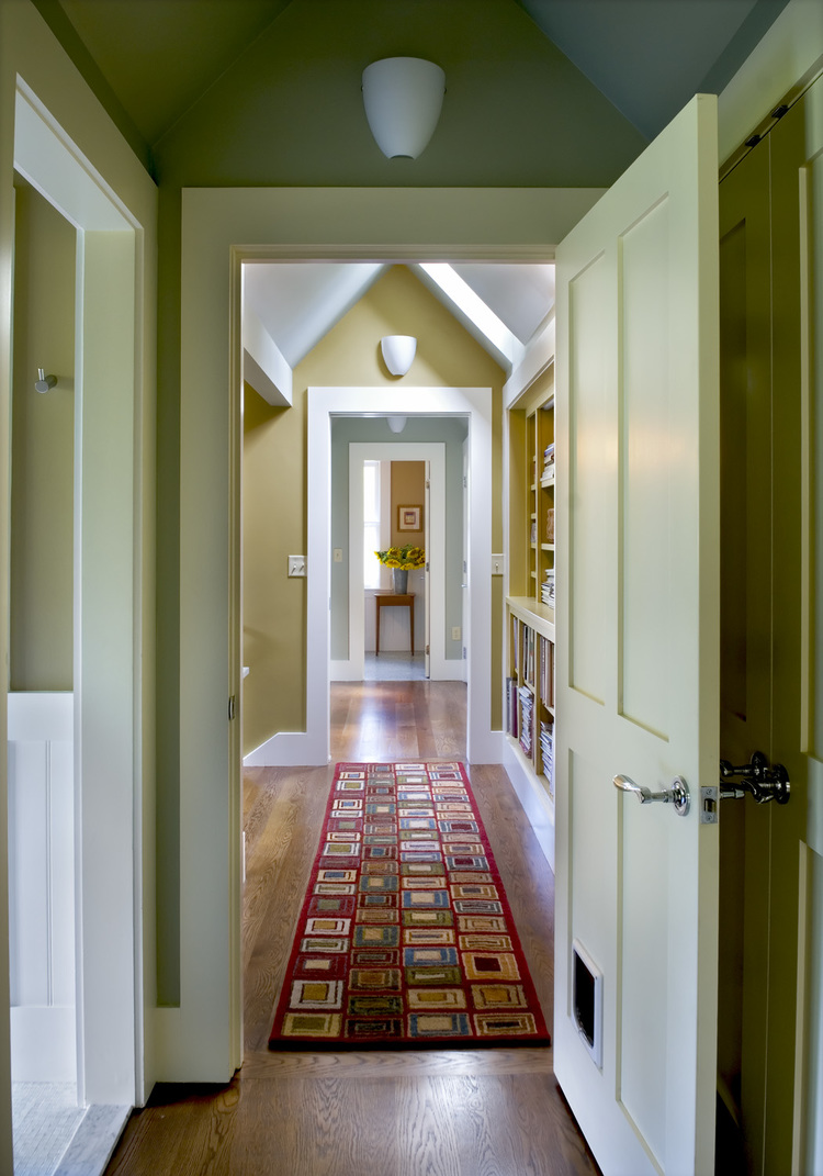 New Custom Farmhouse hallway vaulted ceiling built in bookshelves