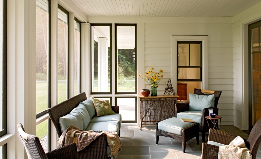 Farmhouse home restored barn sunroom black windows beadboard ceiling