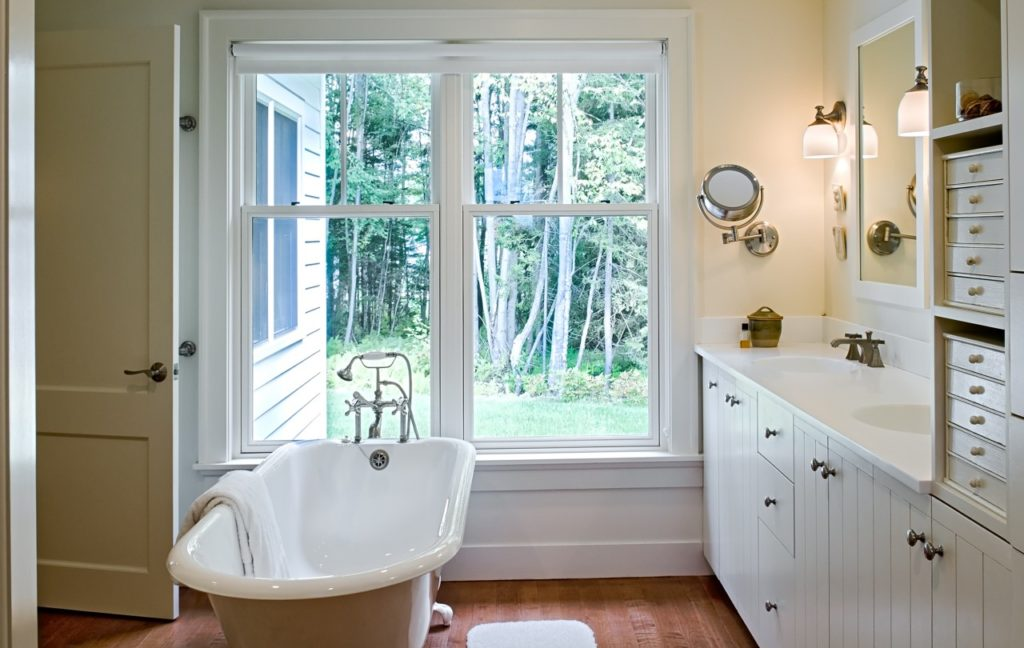 Farmhouse home restored barn master bath beadboard wainscot clawfoot tub