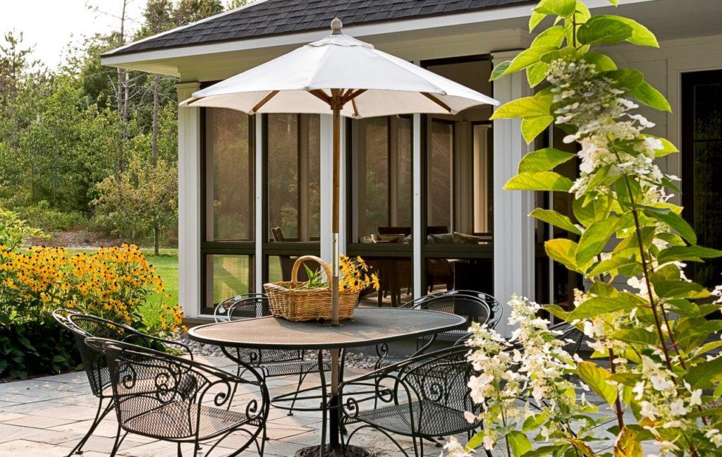 Farmhouse home restored barn outdoor stone patio screened porch