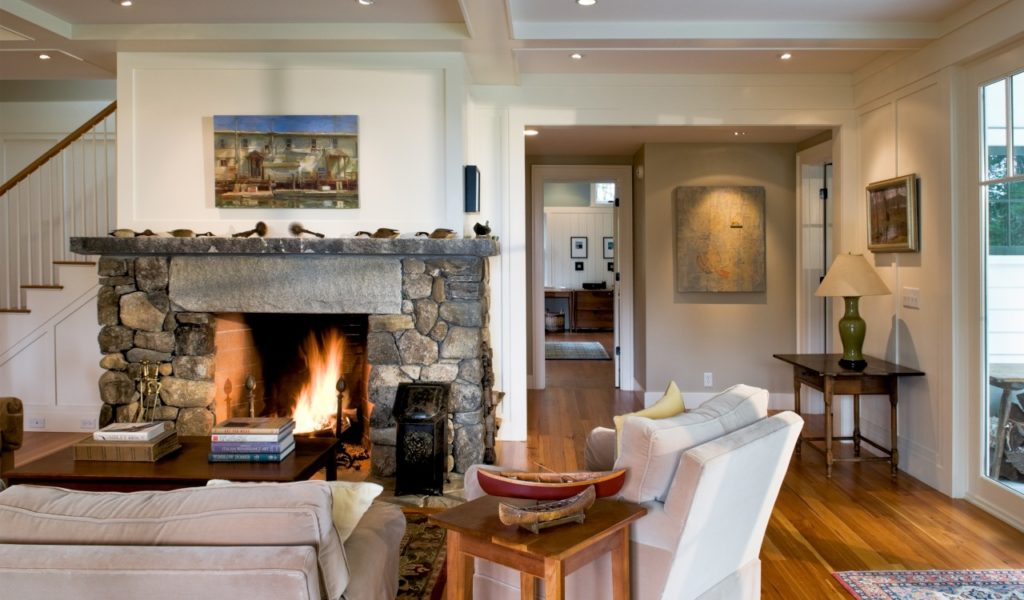 Farmhouse home restored barn stone fireplace hardwood flooring ceiling beams