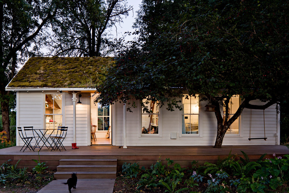 Tiny remodeled cottage reclaimed materials wood deck green roof