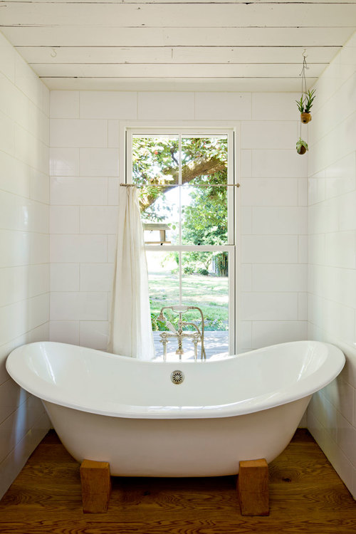 Tiny remodeled cottage bathroom painted board walls ceiling clawfoot tub