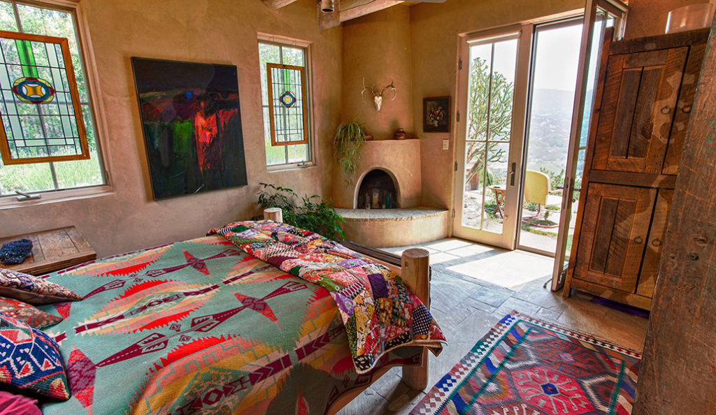 Santa Fe Adobe Pueblo Home exposed log beams mesquite fireplace