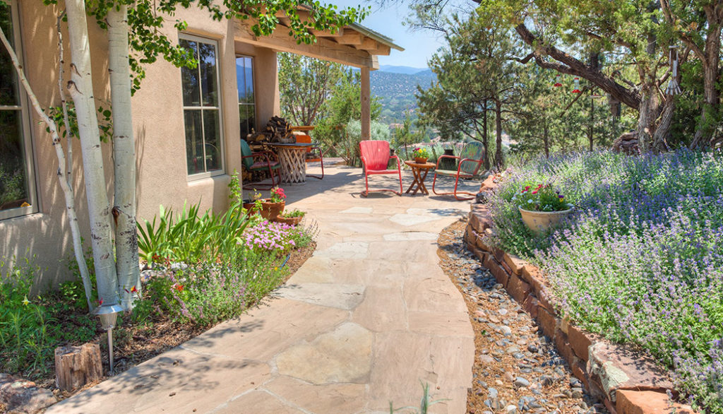 Santa Fe Adobe Pueblo Home outdoor landscape stone path