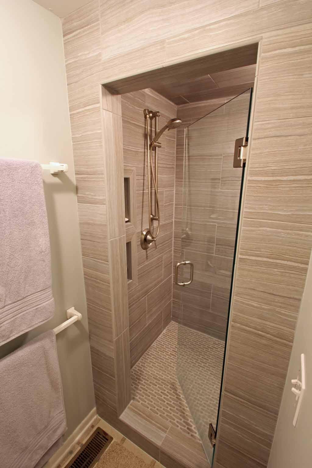 Re-tile master bath shower wand porcelain tile frameless glass door