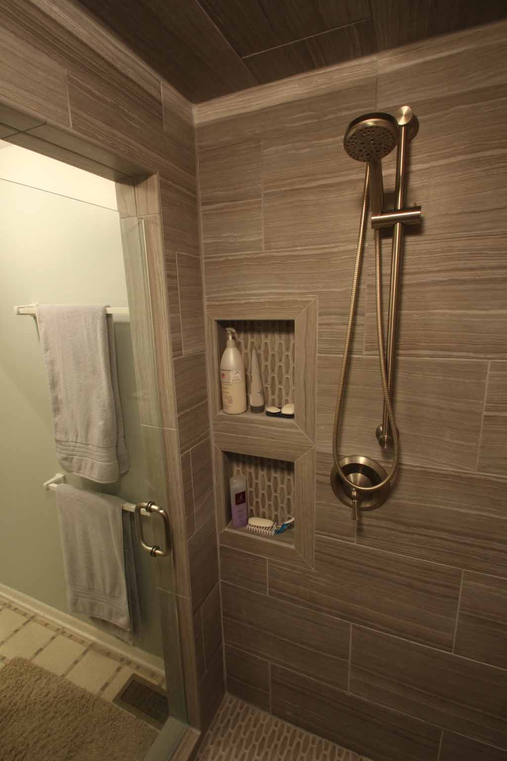 Re-tile master bath shower wand shower seat porcelain tile