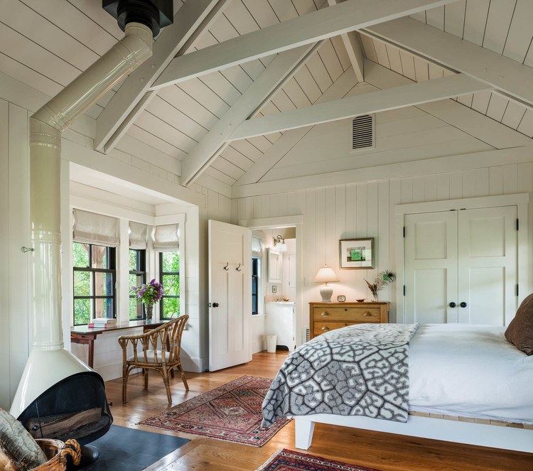 Farmhouse Master Bedroom Wide Plank Floors Exposed Trusses Board Walls and Ceiling