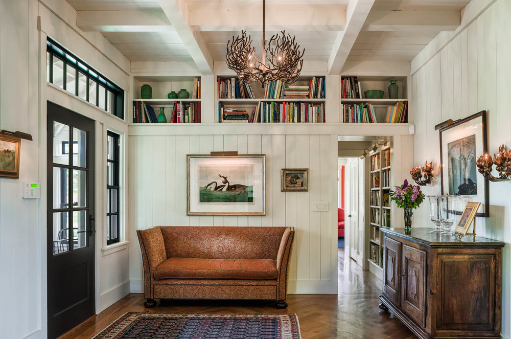 Farmhouse Foyer Herringbone Wood Floors Bookshelves
