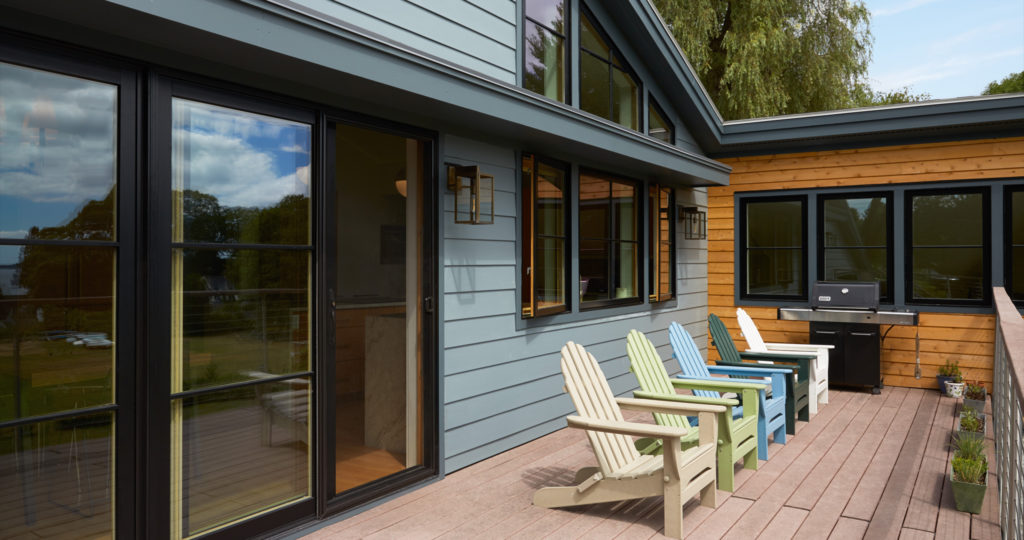 Mid-Century Modern home remodel addition black windows wood deck
