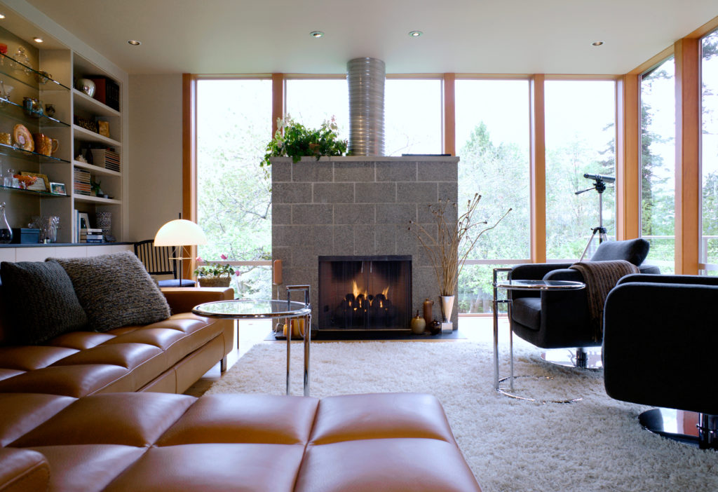 Contemporary Cottage Modern Studio family room concrete block fireplace exposed ceiling beams