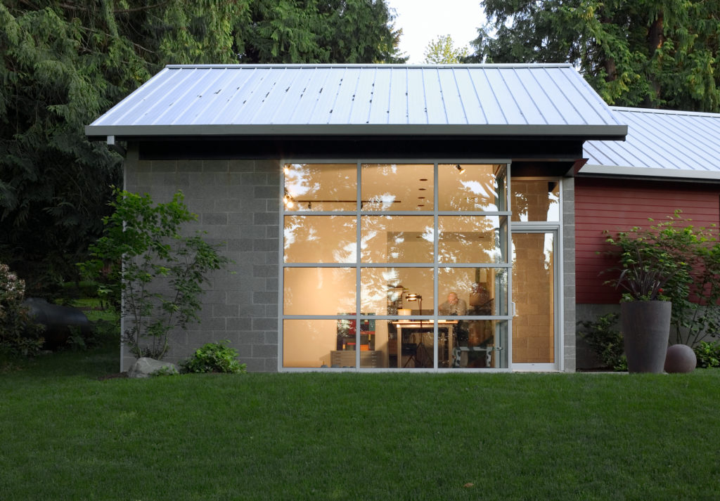 Contemporary Cottage Modern Studio concrete block walls standing seam metal roofing