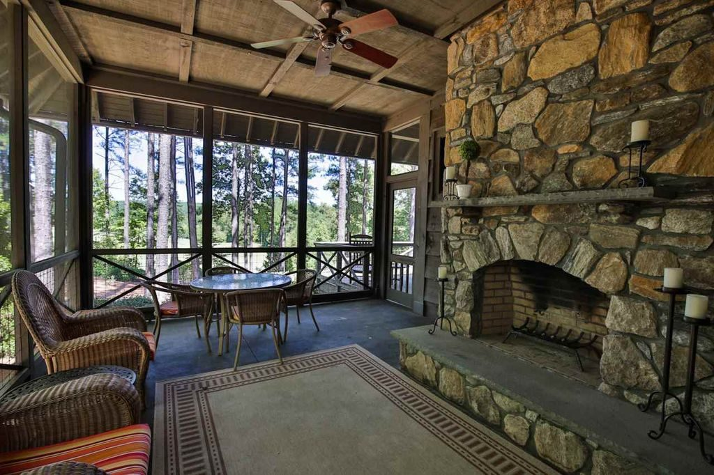 Big Screened Porch Rustic River Rock Fireplace