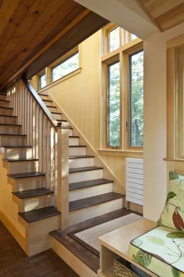 Contemporary lake house remodel open stairwell board ceiling windows