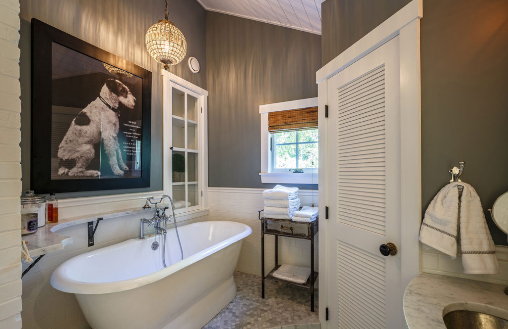 Seaside cottage master bathroom clawfoot tub marble countertop