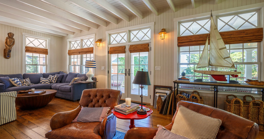 Seaside cottage family room exposed beam ceiling wide plank flooring