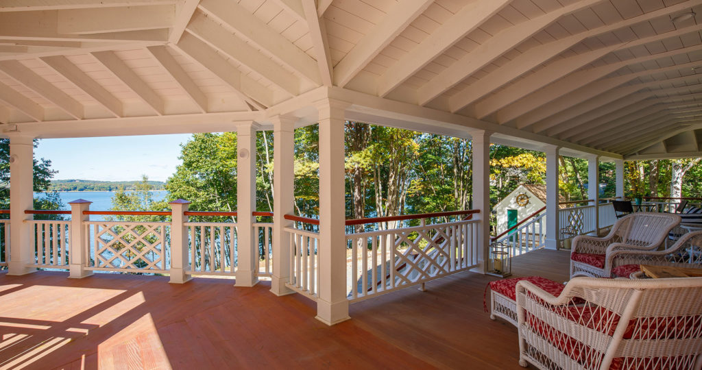 Seaside cottage open porch exposed beams rafters wood flooring