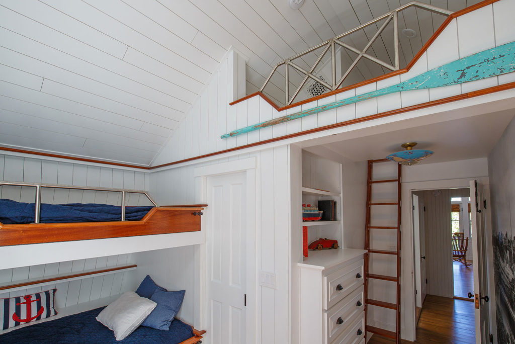 Seaside cottage bedroom bunk beds painted board walls ceiling built in cabintes