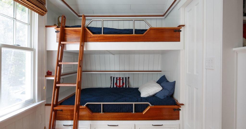 Seaside cottage bedroom bunk beds painted board walls ceiling
