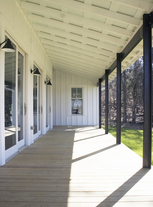 Cabin Remodel Modern Contemporary Farmhouse board and batten open porch exposed ceiling beams