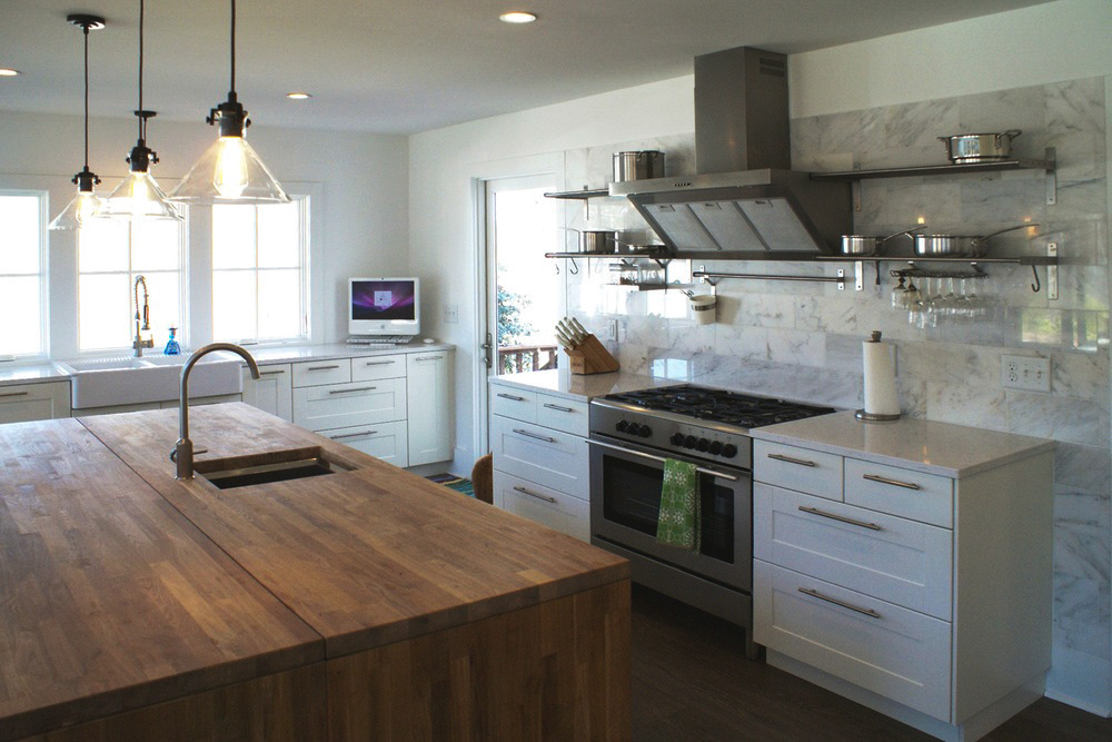 Cabin Remodel Modern Contemporary Farmhouse kitchen marble backsplash wood countertop