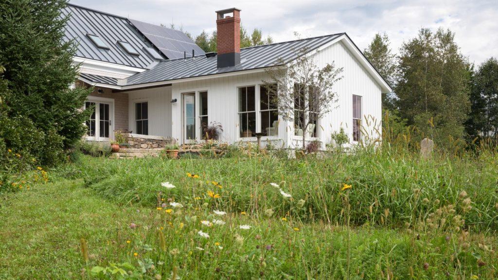 Farmhouse Addition Wildflowers Solar Panels Board and Batten Siding