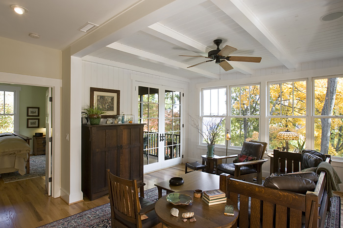 Craftsman Cottage family room ceiling beams wide plank wood flooring