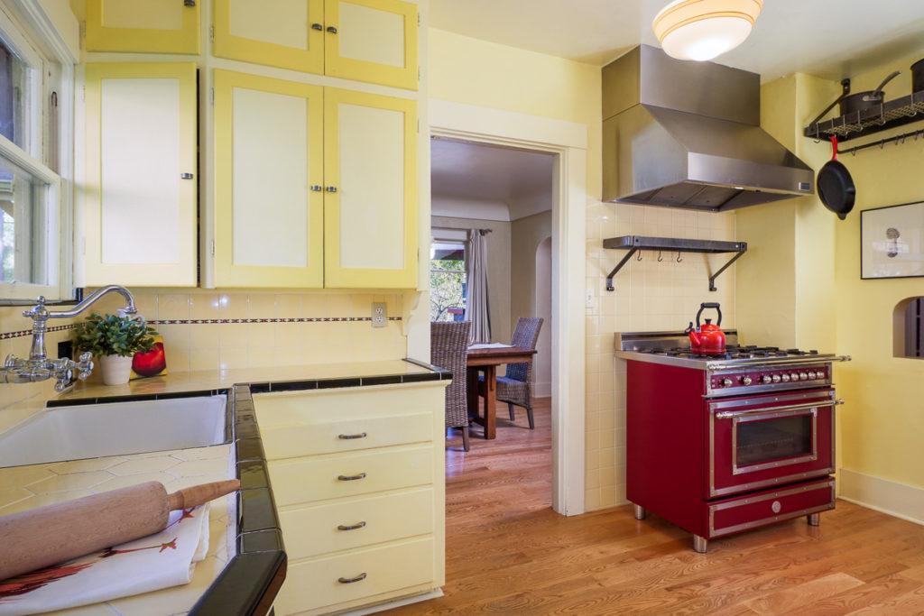 Craftsman kitchen with original cabinet and modern appliances