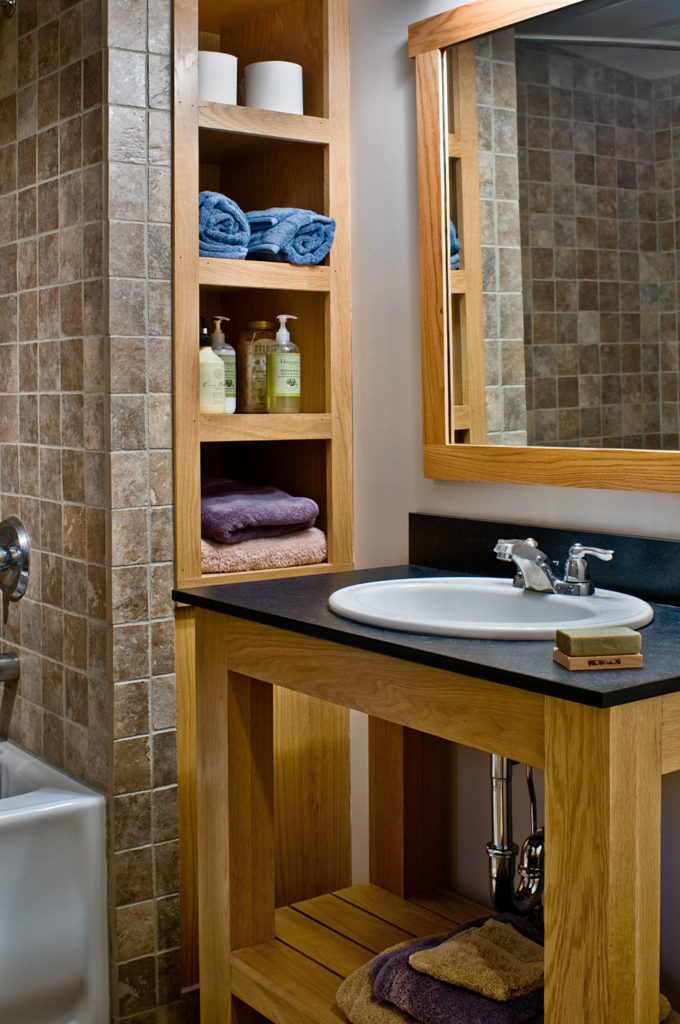 Contemporary bath slate countertop and towel niche