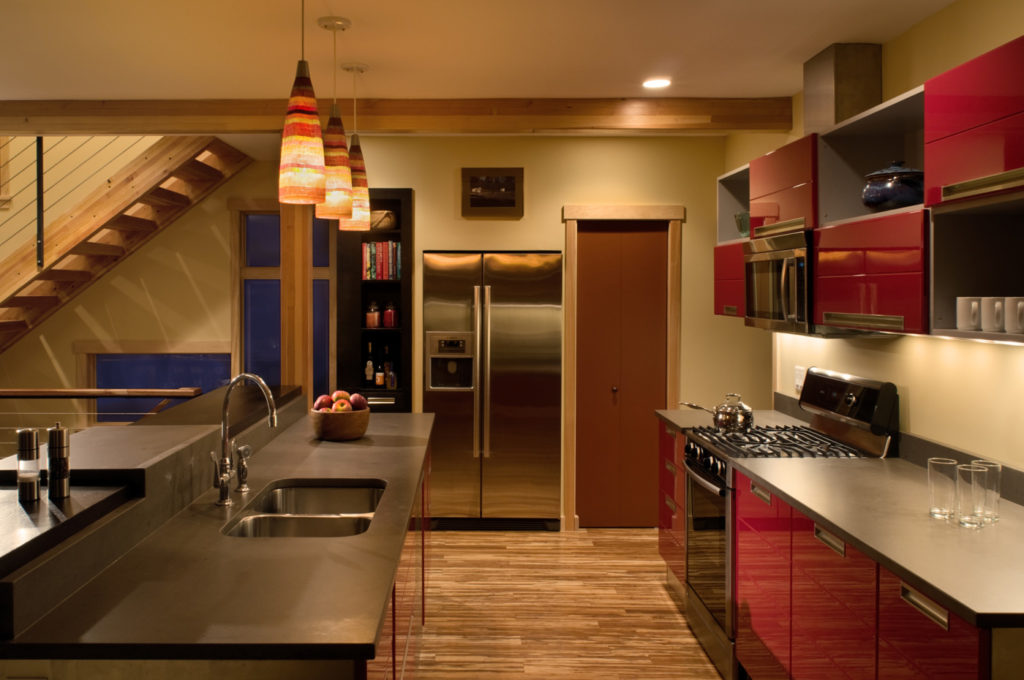 Contemporary kitchen with red cabinets