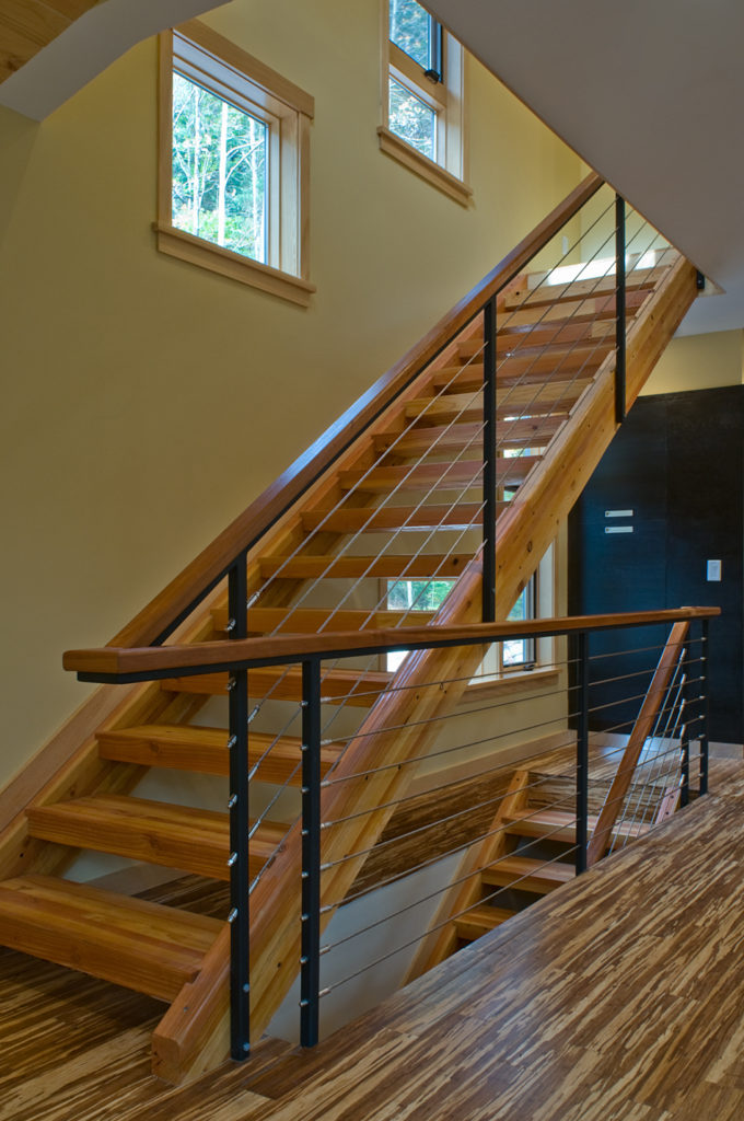 Open riser stair with cable rail and bamboo flooring