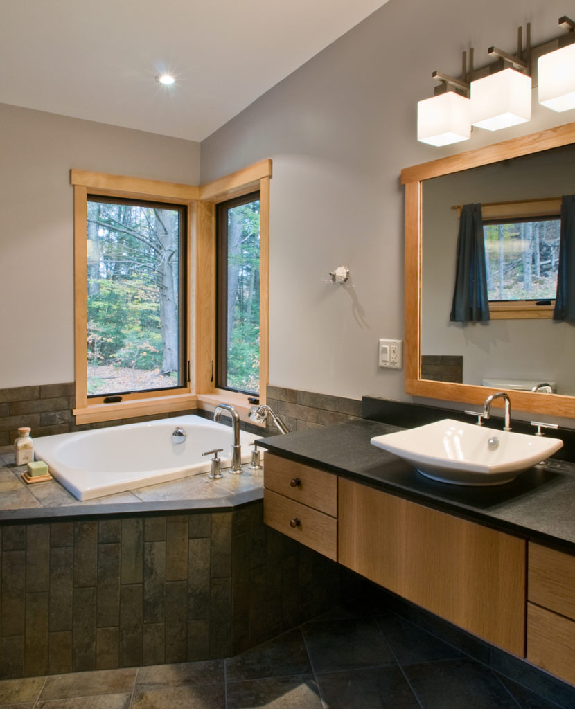 Contemporary bath slate countertop and suspended cabinets