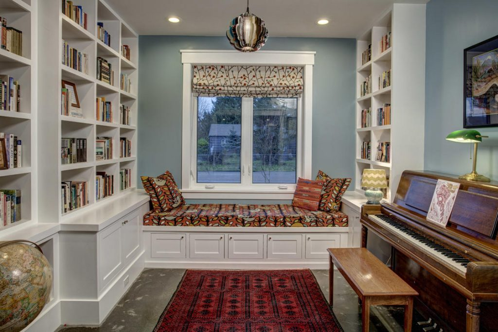 modern farmhouse music room built in bookshelves window seat
