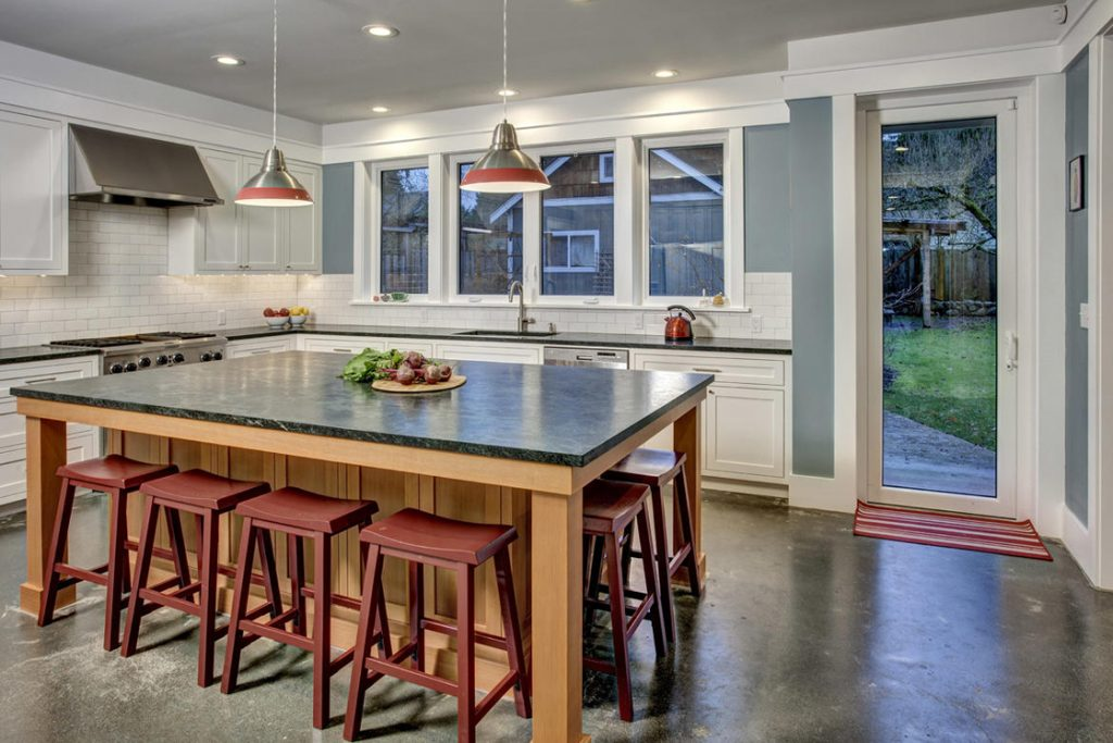 modern farmhouse kitchen big island painted cabinets concrete floors
